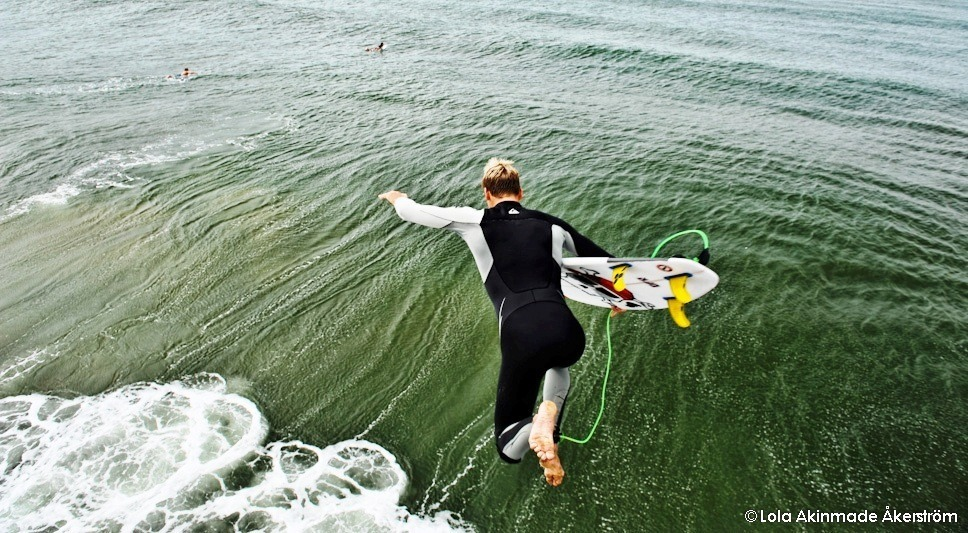 Surfing Lifestyle - Surfers at Durban beach, South Africa - Travel photography by Lola Akinmade Åkerström