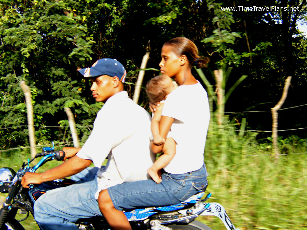 dominican family riding on motorcycle (edited)