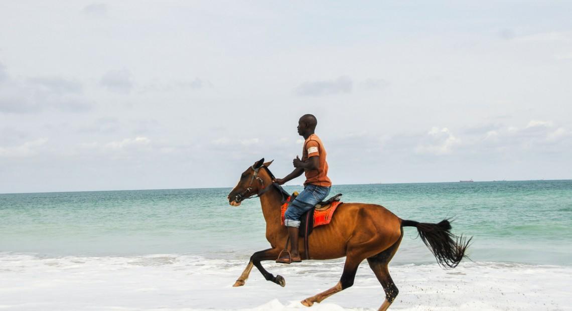 Postcard: Horseback riding at Bar Beach, Lagos